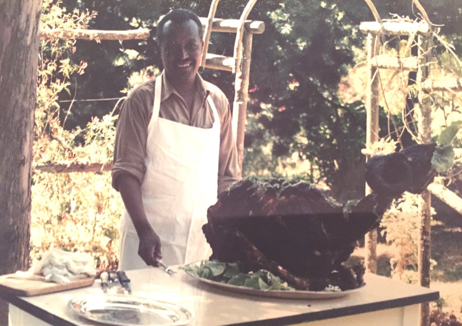 A sheep after being barbecued. Ethiopian cook, Bekele, in the background.