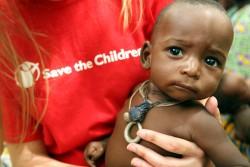 Save the Children UK staff member, Susannah Parker, holds seven month-old Abdou Bassinou at Bande feeding centre
