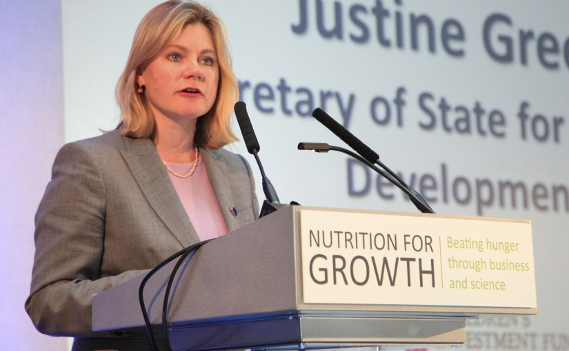 "Justine Greening, Secretary of State for International Development, at a podium labelled ""Nutrition for Growth"""
