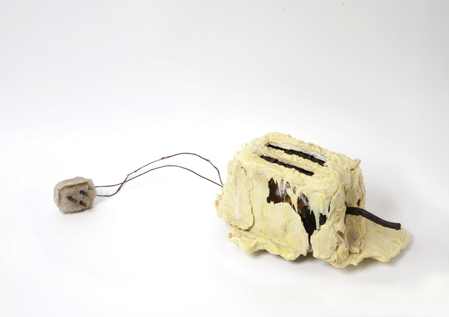 A home-made toaster, looking like a melted toaster