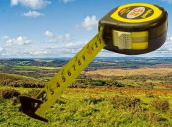 A measuring tape superimposed on the English countryside