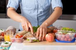 A person making a healthy sandwich