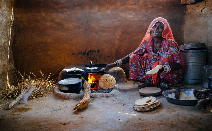 Women preparing food in mud hut on March 20 , 2014 in Jaisalmer,India
