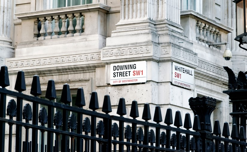 Road signs for Downing Street and Whitehall at the gates of Downing Street