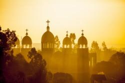 Ethiopian orthodox church with sunrays in Addis Ababa at dawn