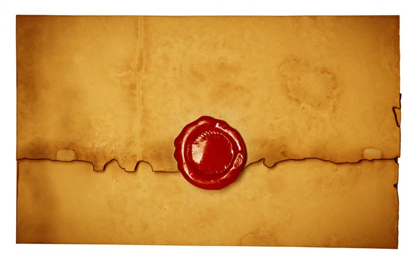 An old envelope with a red wax seal