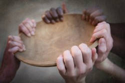 Three pairs of hands holding an empty bowl