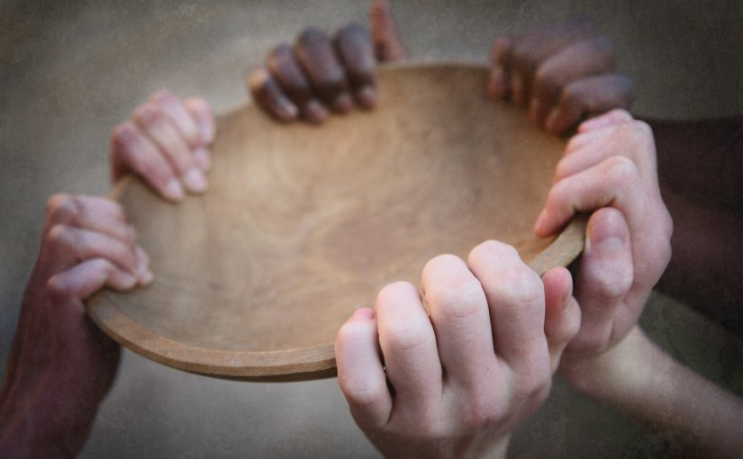 hands holding a wooden plate
