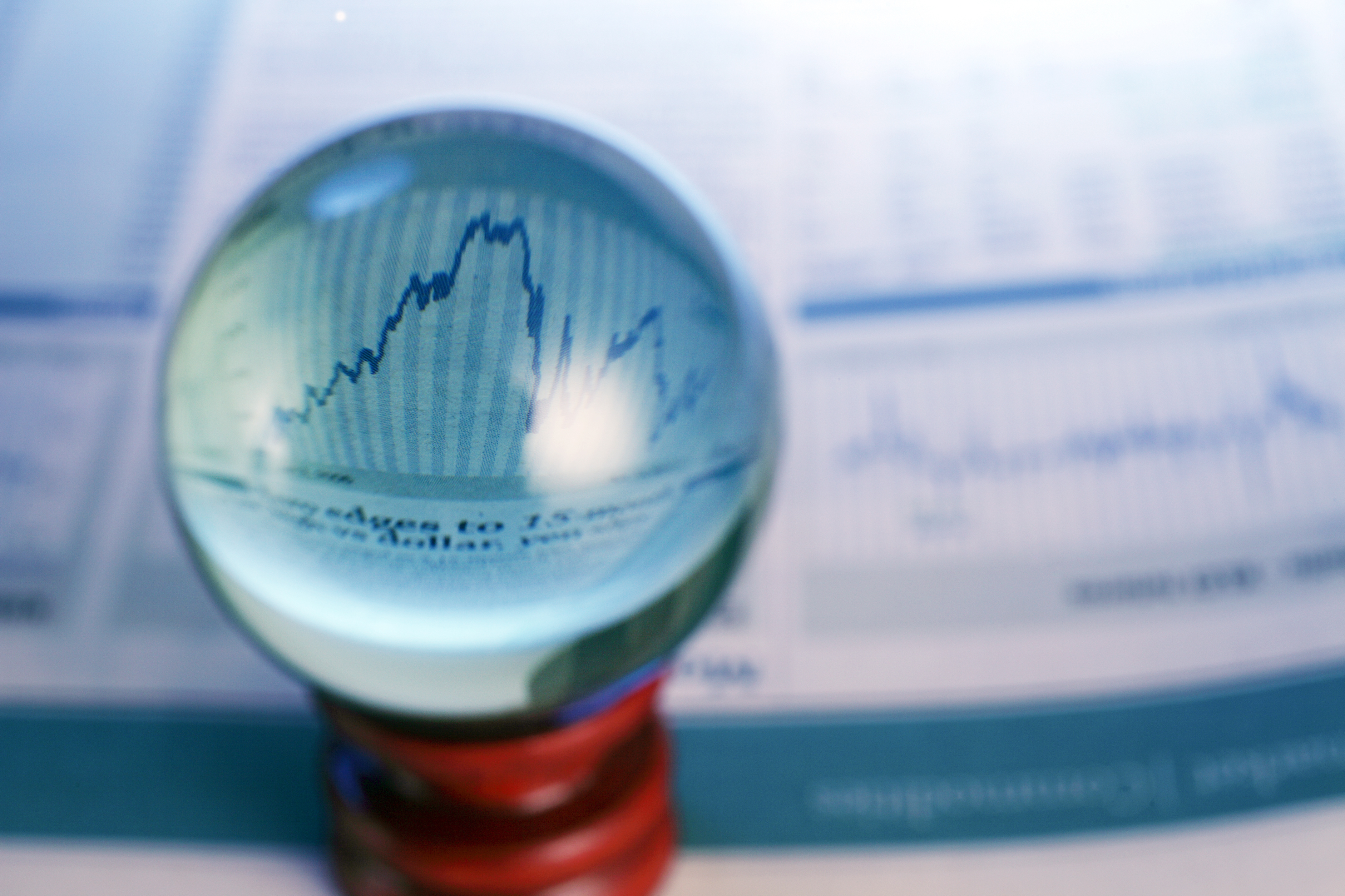 A crystal ball, with a line graph in it.