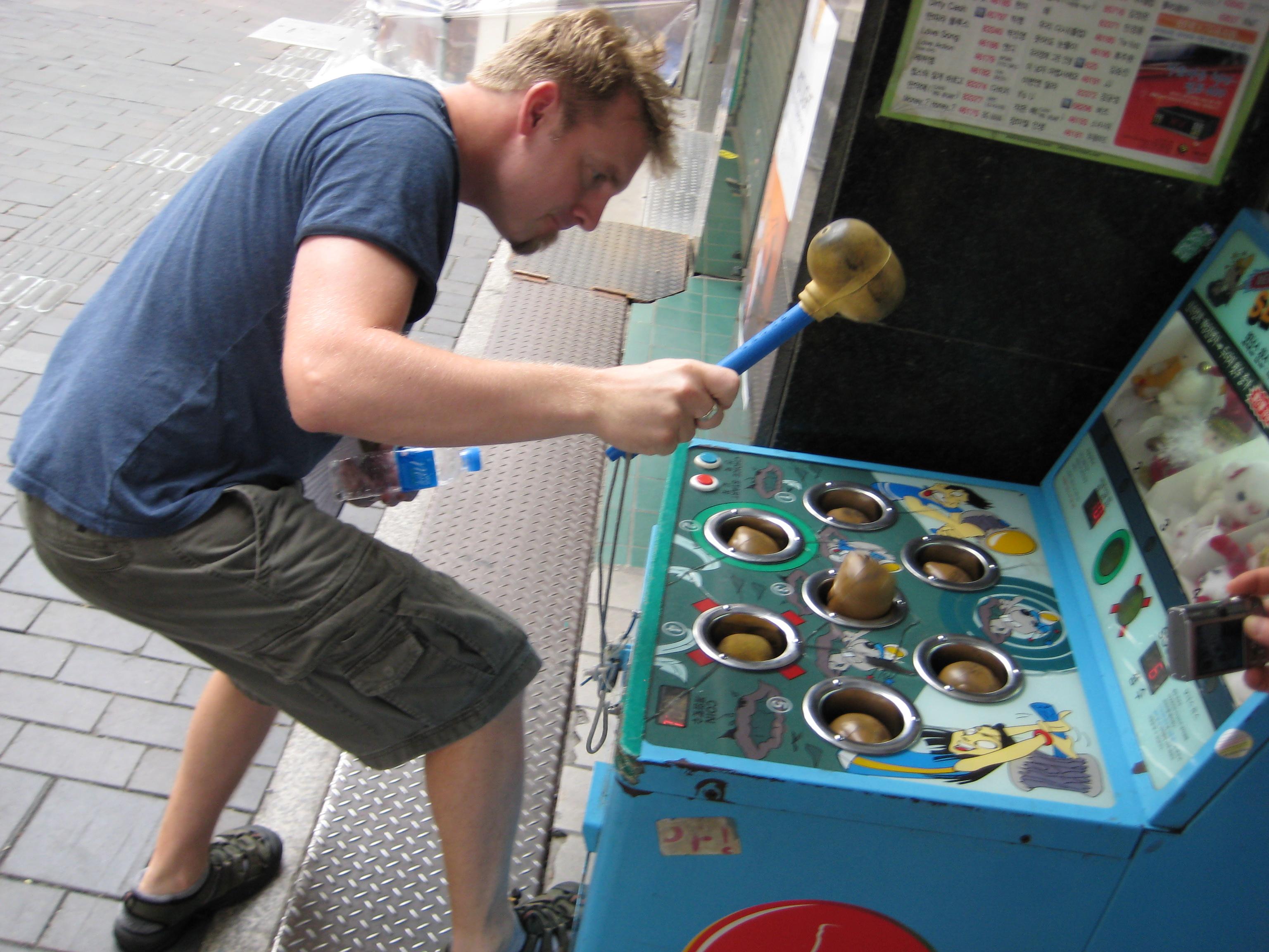 om playing Korean Whack a Mole in Insadong Seoul Korea.